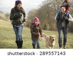 Family And Dog On Country Walk...
