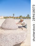 """Small photo of Senior tourist and historic quern, """"Place 20 Aout"""" in Taroudant, Morocco"""