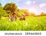 family lying on grass in park... | Shutterstock . vector #289664843
