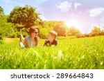 family lying on grass in park... | Shutterstock . vector #289664843