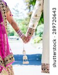 indian bride and groom holding...   Shutterstock . vector #289720643