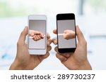 Two Smartphones With Male Hand...