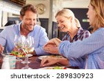 a group of friends eating at a... | Shutterstock . vector #289830923