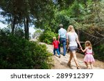 family walking in the forest at ... | Shutterstock . vector #289912397