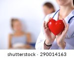 Young Woman Doctor Holding A...
