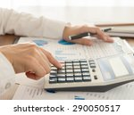 businessman using a calculator... | Shutterstock . vector #290050517