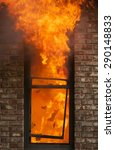 a house burns with flames... | Shutterstock . vector #290148833