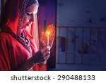 muslim woman holding candle in... | Shutterstock . vector #290488133