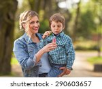 young mother carrying her cute... | Shutterstock . vector #290603657