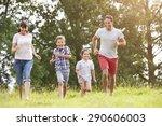 smiling family running across... | Shutterstock . vector #290606003