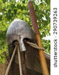 Stock photo an anglo saxon warriors helmet with nose guard sits atop a tent pole 290739263