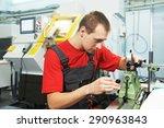 worker in uniform checking... | Shutterstock . vector #290963843
