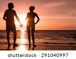 sunset silhouette of young... | Shutterstock . vector #291040997