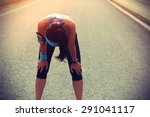 tired woman runner taking a... | Shutterstock . vector #291041117
