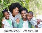 happy family smiling at camera... | Shutterstock . vector #291604343