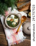 Small photo of Traditional Russian shchi with onions, carrots, potatoes, sorrel, dill, garlic, sour cream and quail eggs
