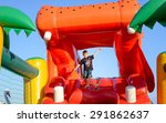 young boy jumping on bouncy... | Shutterstock . vector #291862637