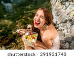 woman eating healthy salad from ... | Shutterstock . vector #291921743