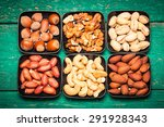 mix nuts on wooden table... | Shutterstock . vector #291928343