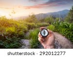 hand with compass at mountain... | Shutterstock . vector #292012277