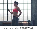 a fit woman is looking down at... | Shutterstock . vector #292027667