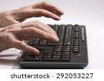 old hands on the black keyboard | Shutterstock . vector #292053227