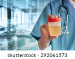 Doctor Hand With Urine Container