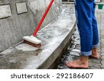 outdoor cleaning with red brush. | Shutterstock . vector #292186607