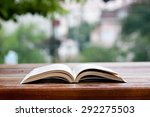 a book on a table  reading at