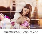 mother breast feeding her... | Shutterstock . vector #292371977