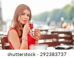 pretty woman with tea cup in... | Shutterstock . vector #292383737