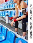 Small photo of Modern girl in activewear spending time at stadium