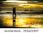 Silhouette Of Two People In...