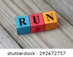 word run on colorful wooden... | Shutterstock . vector #292672757