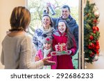 family delivering presents at... | Shutterstock . vector #292686233