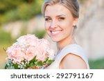 smiling bride holding big... | Shutterstock . vector #292791167