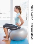 Woman Sitting On Exercise Ball...