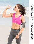 pretty fit woman drinking water ... | Shutterstock . vector #292923023