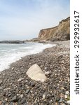 Small photo of Parc trammel cove Cornwall England UK on the pebble strewn beach between rinsey head and porthleven