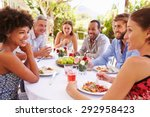 friends dining together at a... | Shutterstock . vector #292958423