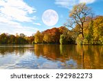 Stock photo on a lake stands a colorful autumnal forest 292982273