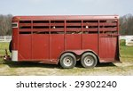 horse trailer with horses inside - stock photo