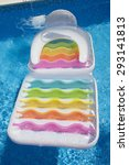 Small photo of Colorful floating air mattress in swimming pool at summertime as background