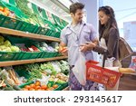 young couple shopping in a... | Shutterstock . vector #293145617