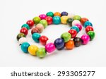 Colored Wooden Beads On A Whit...