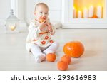 young baby girl with pumpkins | Shutterstock . vector #293616983