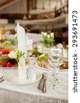 serving a festive table... | Shutterstock . vector #293691473