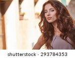 beautiful woman on the streets... | Shutterstock . vector #293784353