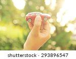 hand holding car toy with...   Shutterstock . vector #293896547