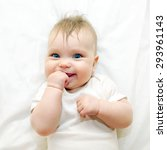 smiling baby sucking his finger ... | Shutterstock . vector #293961143